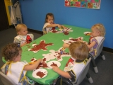 Ruby children painting with chocolate pudding