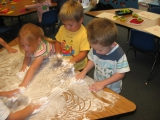 Emerald 1 playing with shaving cream